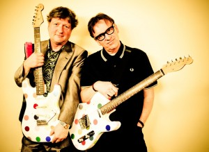 Glenn Tilbrook and Chris Difford with Damien Hirst guitars